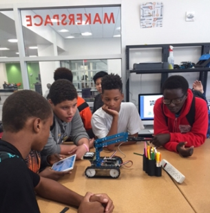 Group of teens working with robotics