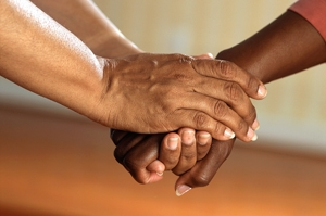 Clasped hands showing support and representing community